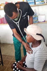 Doctor taking vitals at clinic
